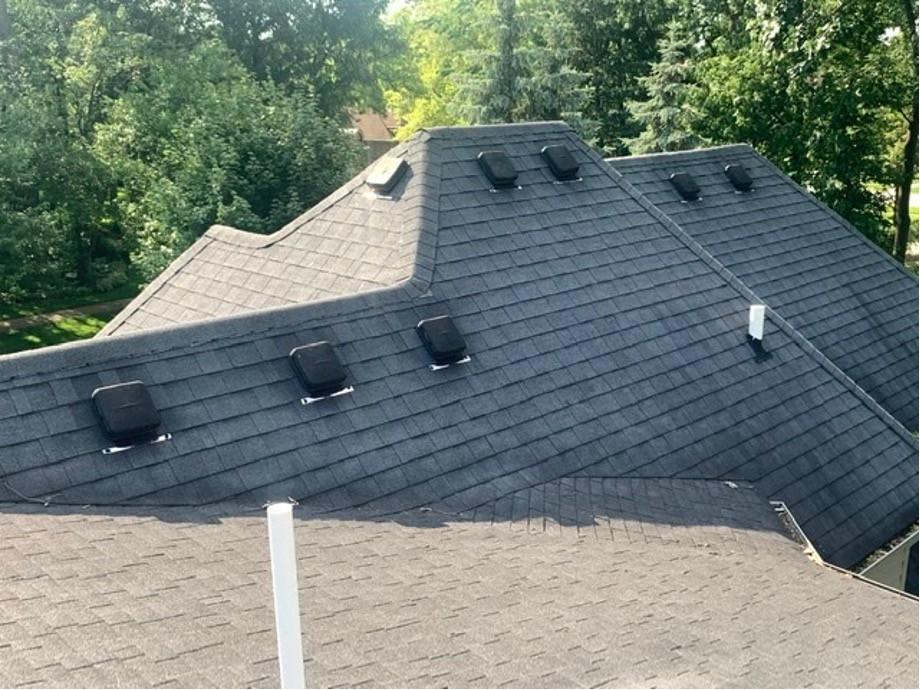 Roof ridge shingles with black vents
