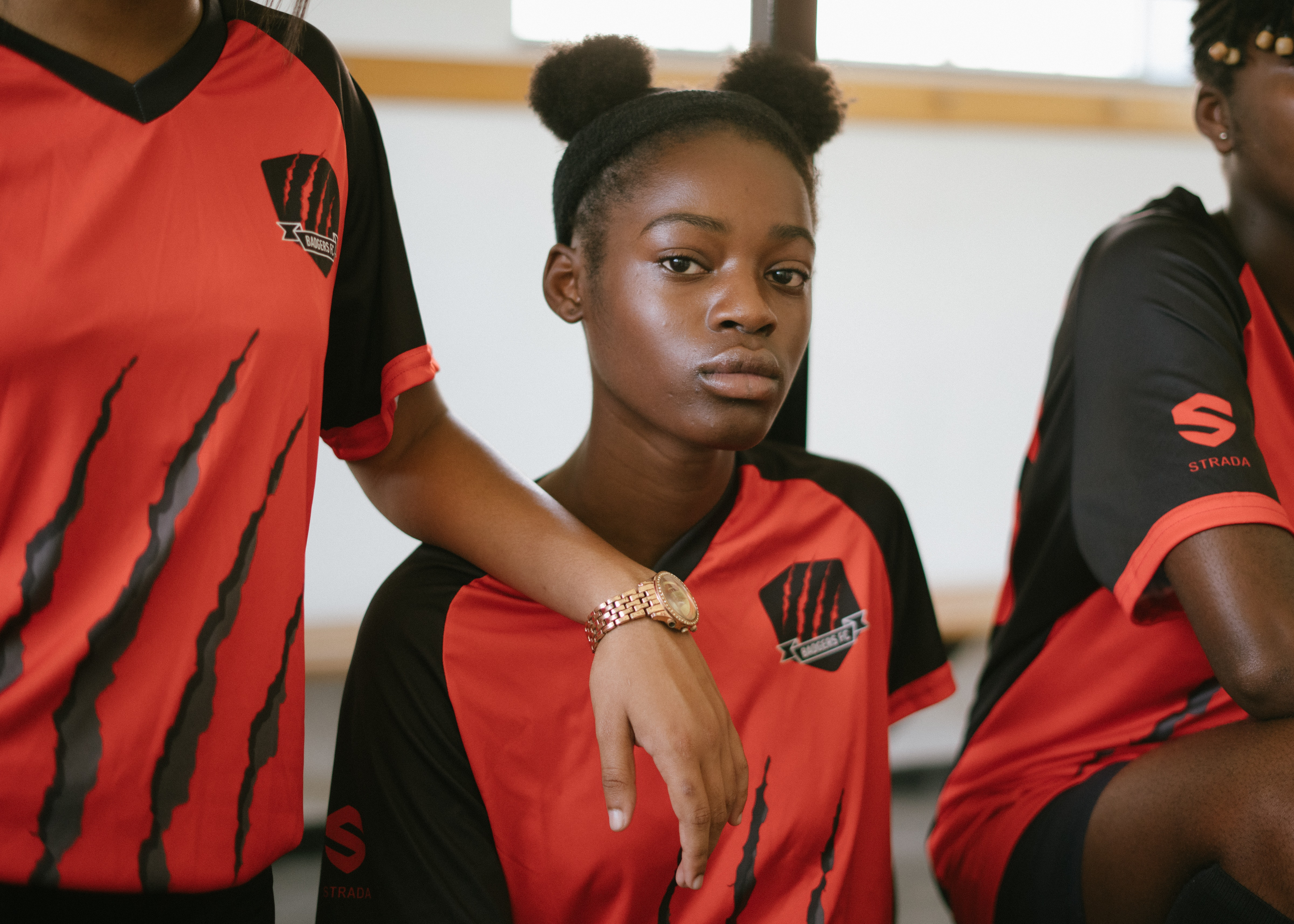 black-confident-sportswomen-wearing-team