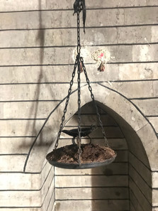 An oil lamp hangs inside the holy temple at Lalish
