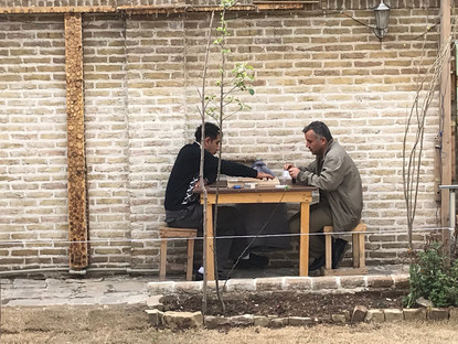 Men enjoy a game of backgammon in a local tea house