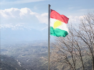 A Kurdish flag flies over the hill town of Amedi