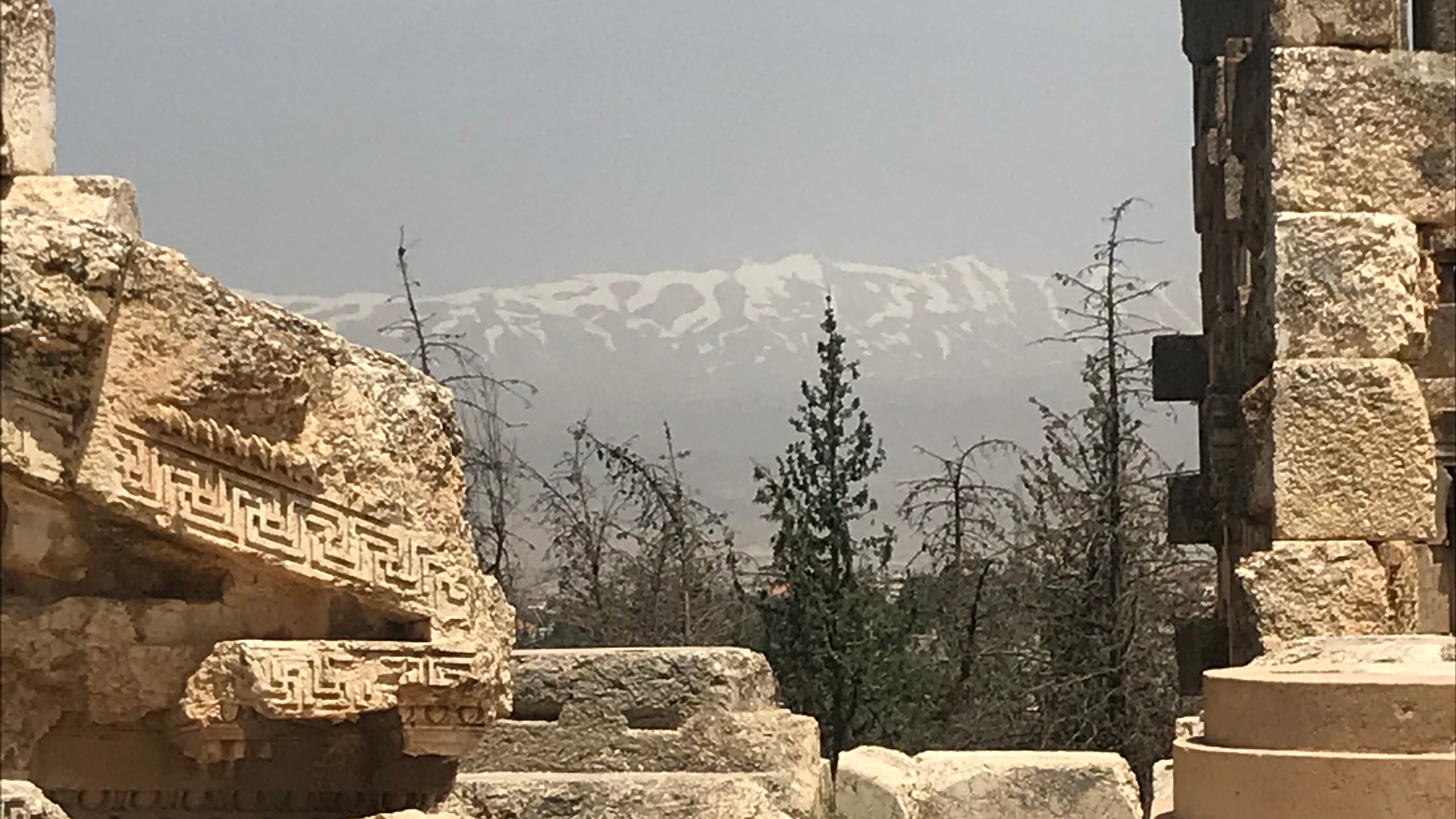 Snow-capped mountains ring the Bekaa Valley near Baalbek