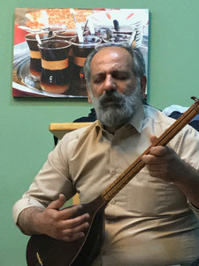 A local musician plays the tar, a traditional instrument