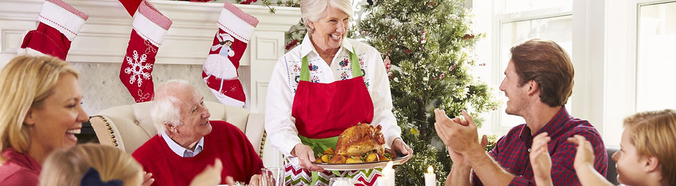 Grandmother Bringing Out Turkey At Famil