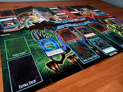 A close-up shot of a Yu-Gi-Oh! Speed Duel game being played on a wooden table.