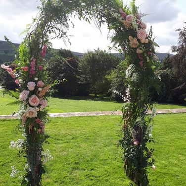 Summer Wedding Archway by Flower Design