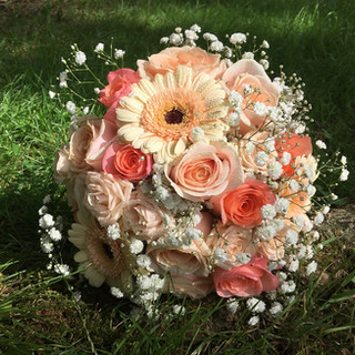Gorgeous 'Pearl Avalanche' and Coral Roses are included in this beautiful Bride's Hand-tied Wedding Bouquet.  Designed and photographed by Flower Design, Ripon. North Yorkshire