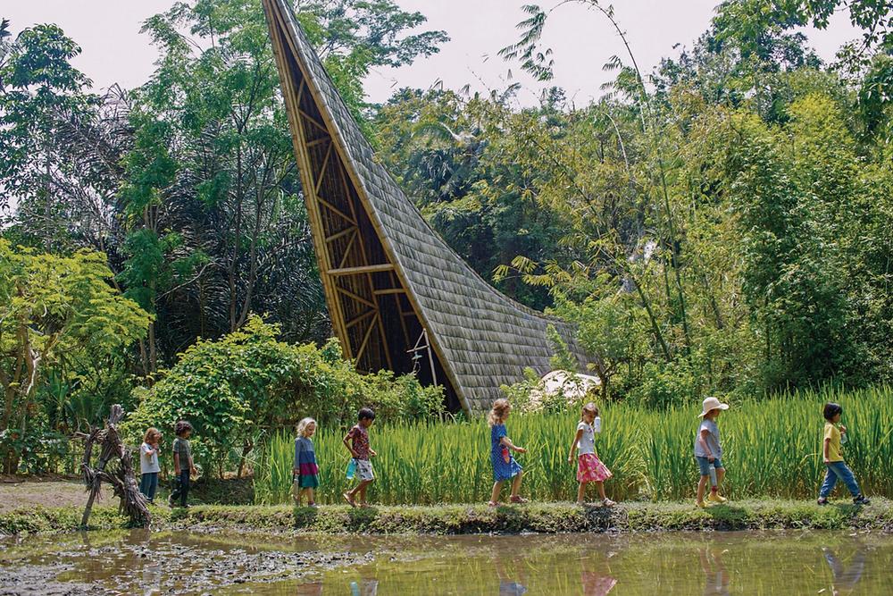 Children walking around the The Green School campus