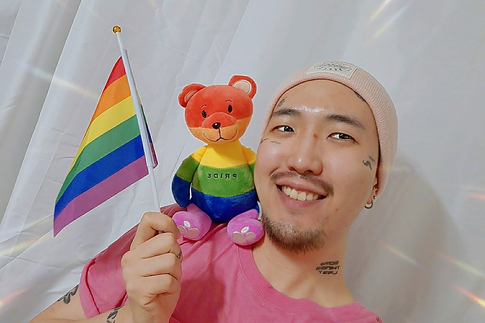 Queer Artist and Activist Heezy Yang with Rainbow Items