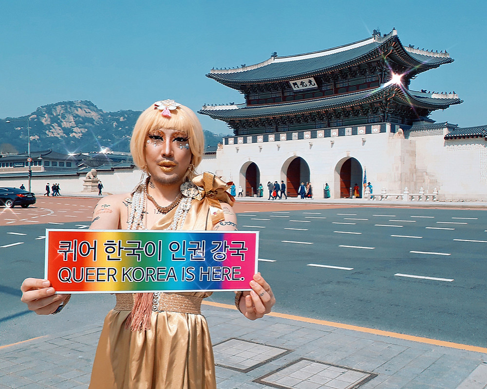 korean drag queen and lgbtq artist and activist heezy yang aka hurricane kimchi protests in front of kyungbok palace in seoul in drag