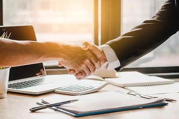insurance agent shaking hands.jpg