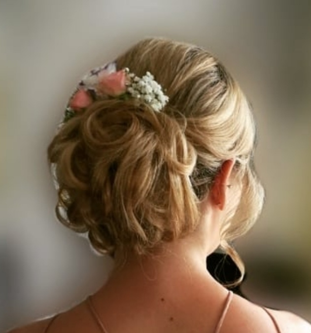 Bridesmaid. Curled bun with flowers