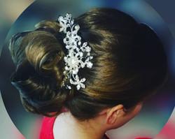 Bridesmaids hair, curled bun.