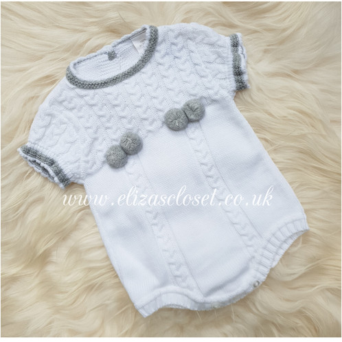 23fc557d8 Spanish style Baby short sleeved knitted romper with pom pom decoration