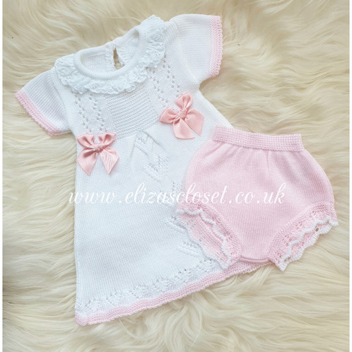 9880cadd7 Stunning Spanish Baby Girls white knitted dress with pink trim and frilly  collar. Finished with two silk chest bows. Complete with a pair of pink  knitted ...