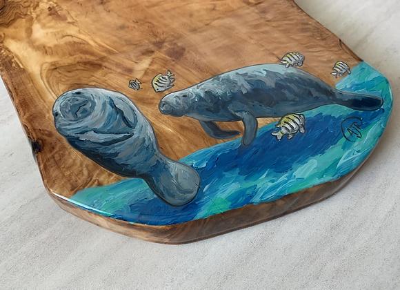 Manatee and fish charcuterie board