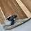 Thumbnail: Baby sea turtle hatchling on acacia wood cutting board