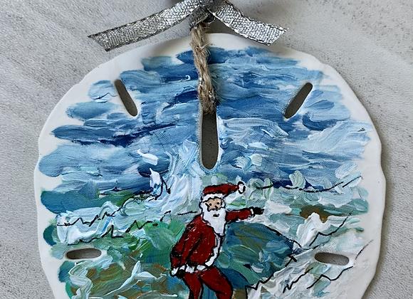 Santa Clause surfing a wave sand dollar ornament