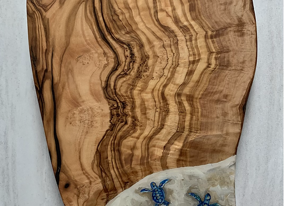 Baby sea turtle on Olive wood cutting /charcuterie board