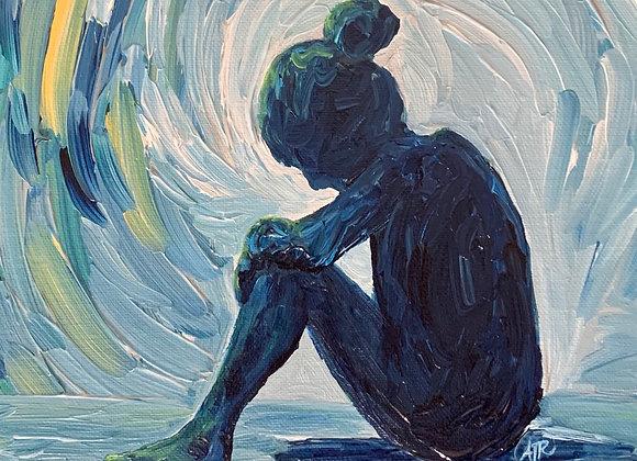 Girl sitting in sadness