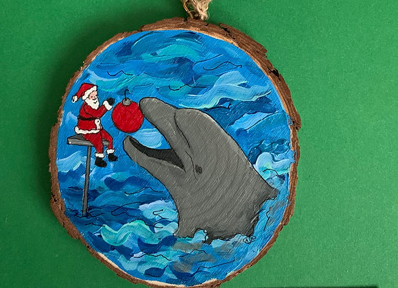 Dolphin playing with Santa ornament