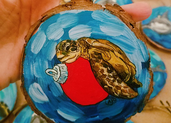 Red ornament with sea turtle