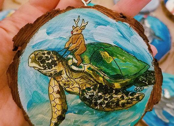 Reindeer riding sea turtle ornament