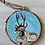 Thumbnail: White reindeer with Santa hat ornament