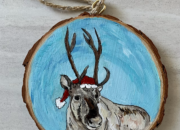 White reindeer with Santa hat ornament