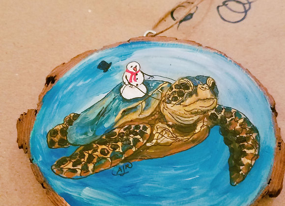 Sea turtle with snowman riding ornament