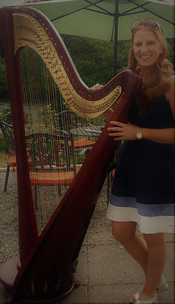 Miriam Long playing the concer harp for aftenoon tea na beautiful setting in West Cork.