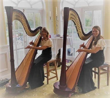 Miriam Long and Nancy Long playing two concet harps in a beautiful West Cork hotel in the dining area.
