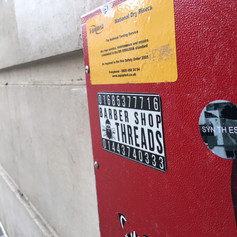 Sticker campaign questioning the role of high and low art according to means and placement of art