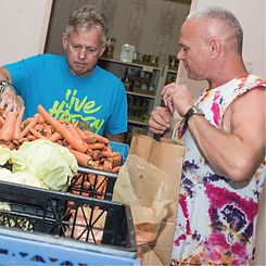 Volunteer packing vegetables for Esther's Pantry
