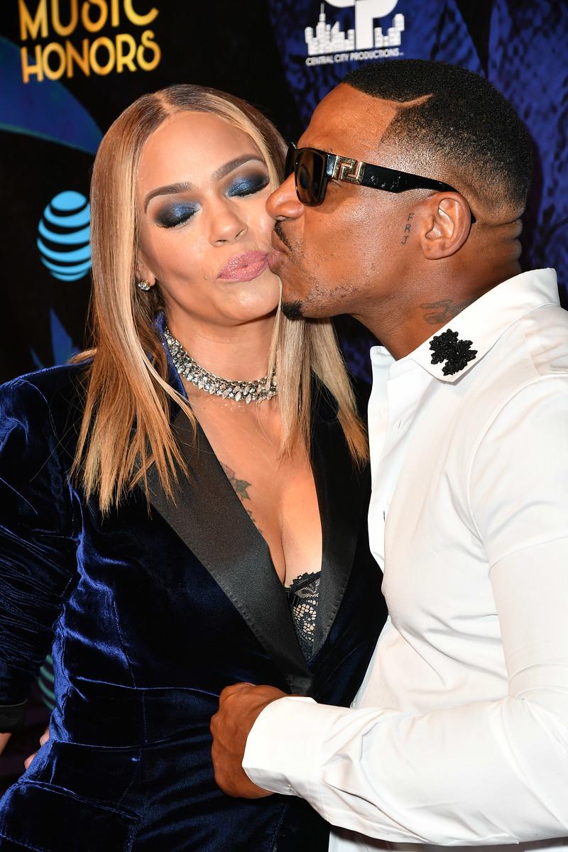 Faith Evans and Stevie J share a kiss