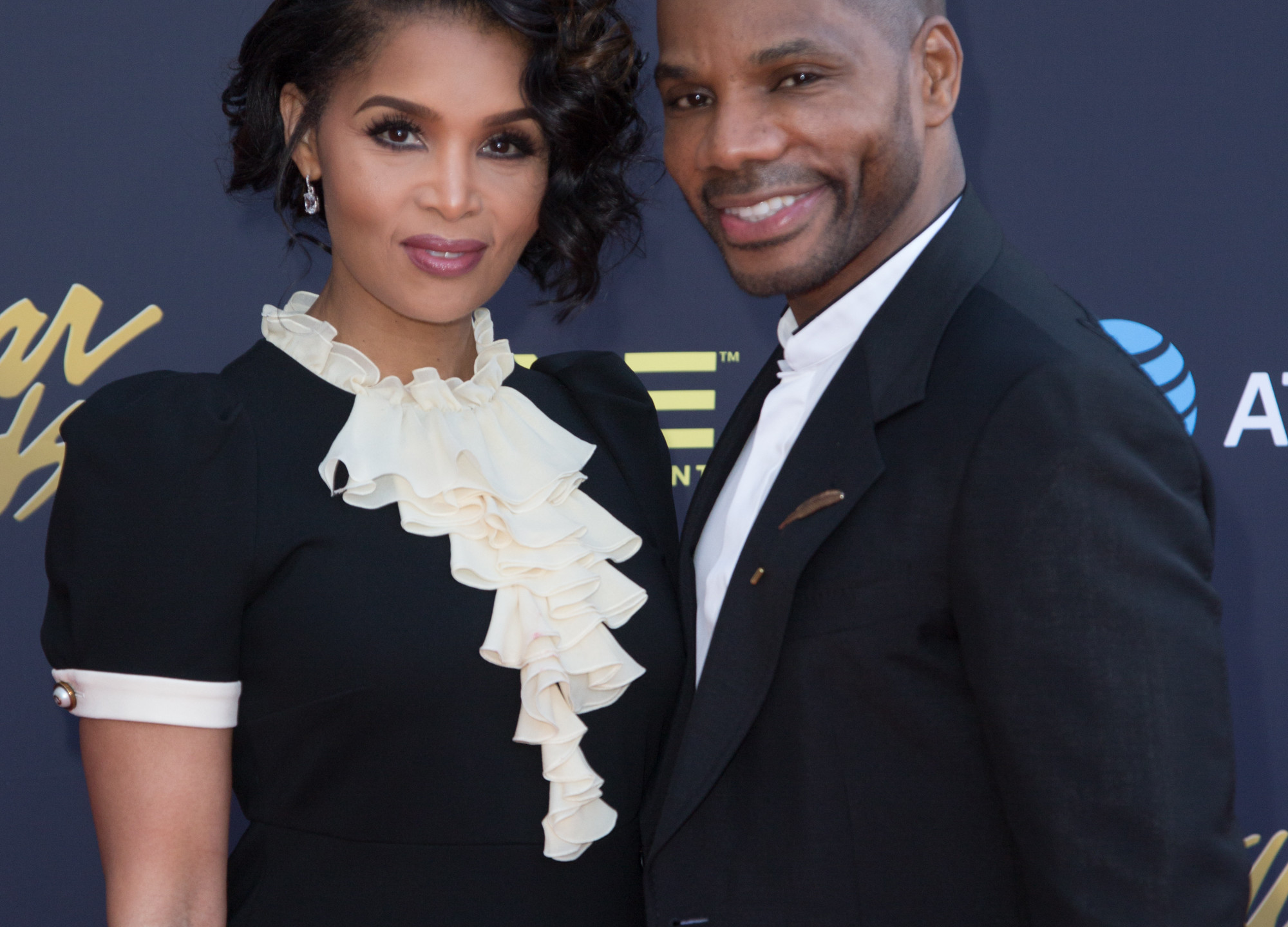 Tammy Franklin and Kirk Franklin on carpet by Maury Phillips