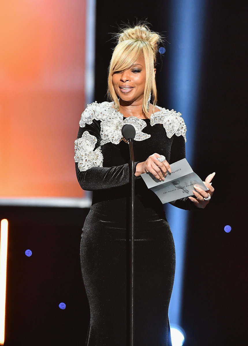 Mary J. Blige speaks onstage