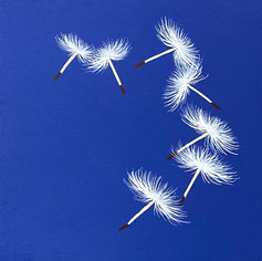 Poofs Floating on Blue