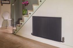 02-trubi-radiator-in-volcanic-in-hallway