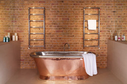 01-pera-towel-rail-radiators-in-stainless-steel-mirror-finish-in-bathroom