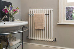 02-tetro-towel-rail-radiator-in-white-ral-9010-in-cloak-room-bathroom