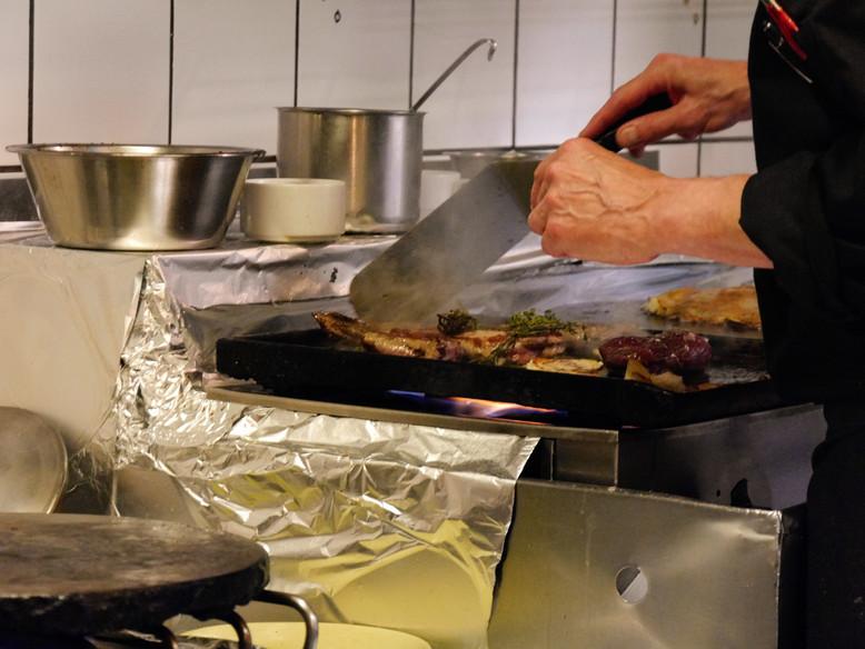 Zubereitung von Essen im Prison St. Michel