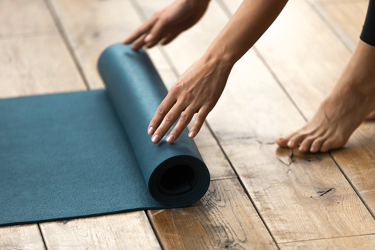 Fit beautiful woman folding blue exercis