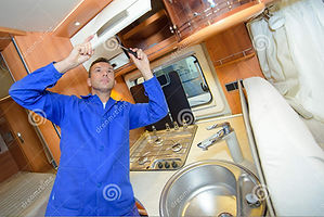 mechanic-working-interior-camper-van-830