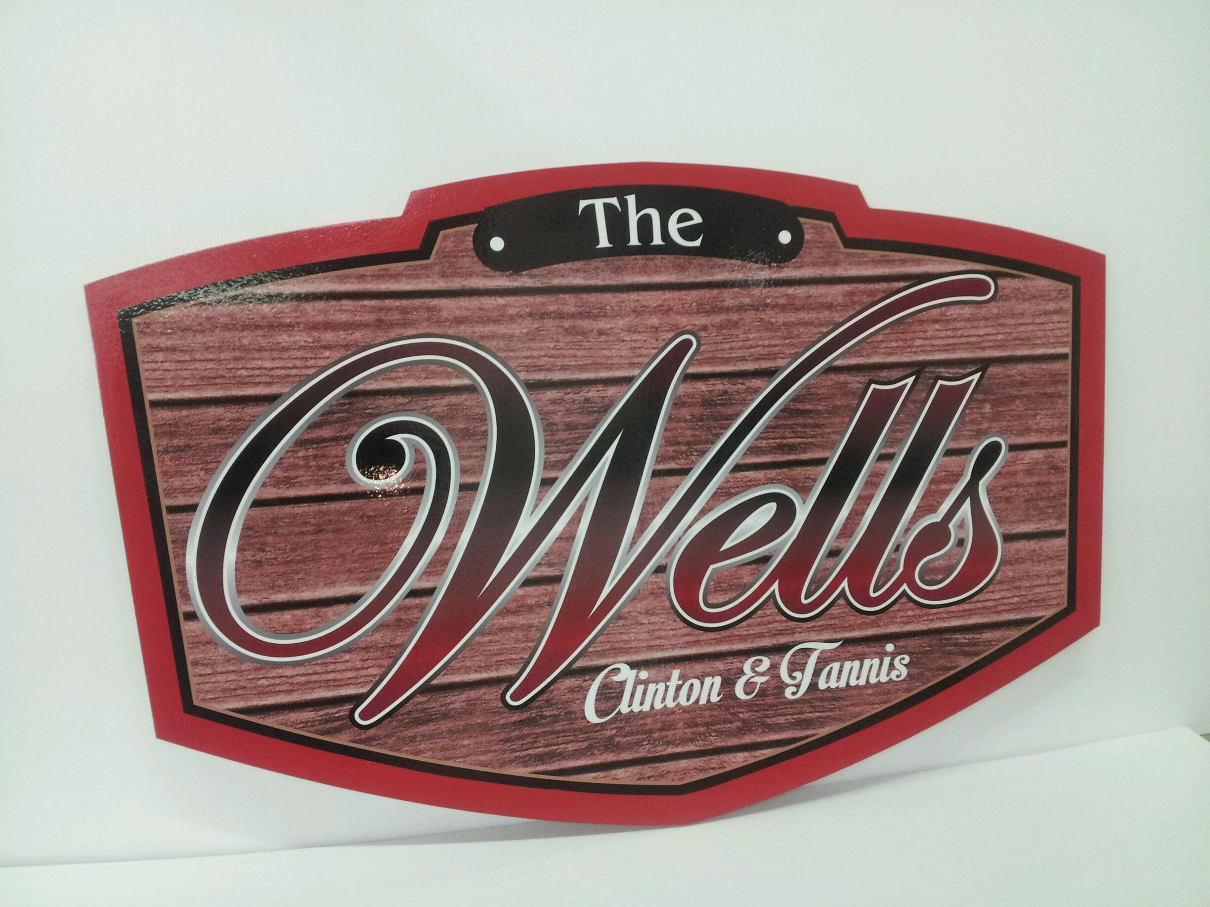 Wells cabin sign