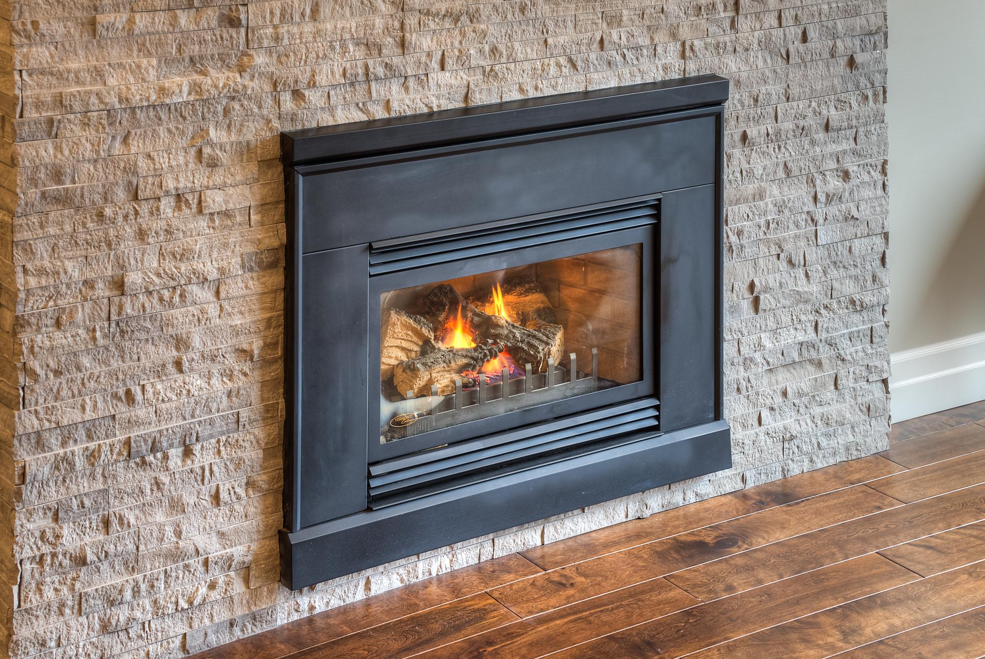 Stone veneer fireplace