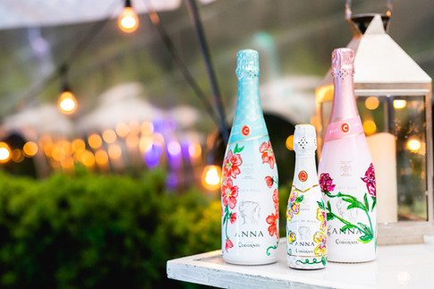 The famous Anna de Codorníu mini bottles of Cava, hand-painted by Madison Lee (of Madison Lee's Cakes)