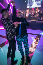 Ron Ben-Israel getting twirled on that custom dance floor by HiTECH Events!
