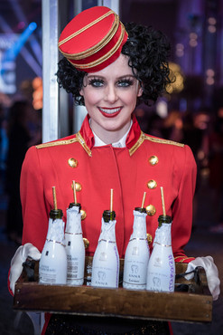 One of Tryon Entertainment's Cigarette Girls serving mini bottles of Anna de Codorníu Cava to guests as they arrived.