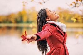 woman arms open autumn.jpg